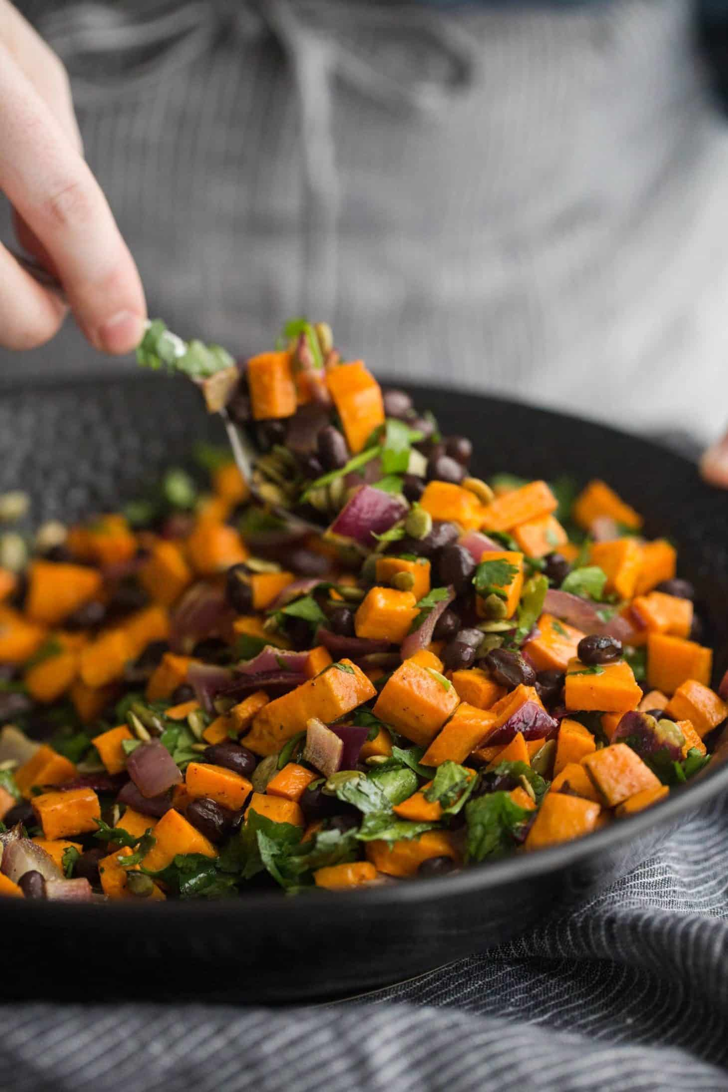 Tossing the black bean salad