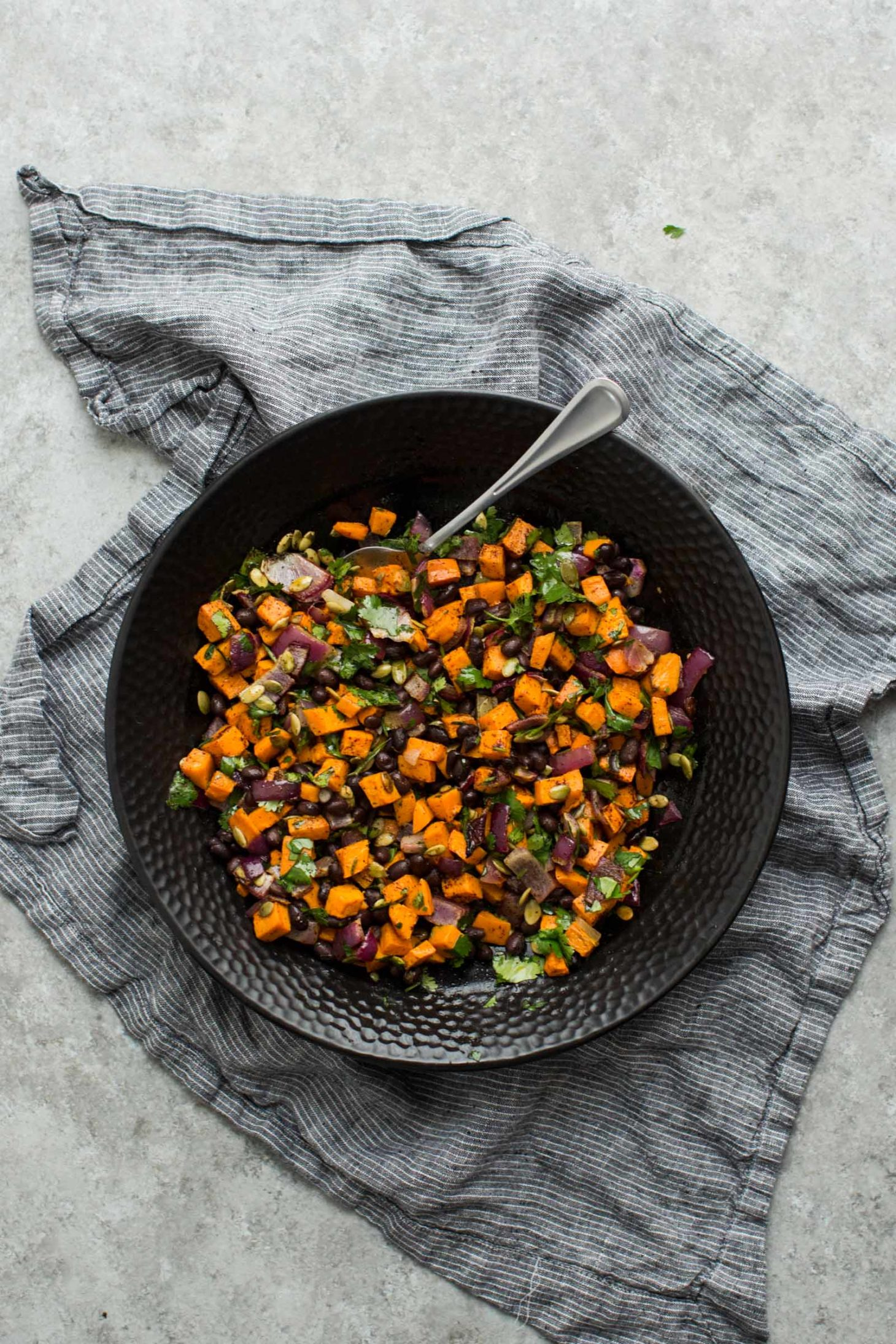 Black Bean Salad with Roasted Sweet Potatoes and Pepitas | @naturallyella