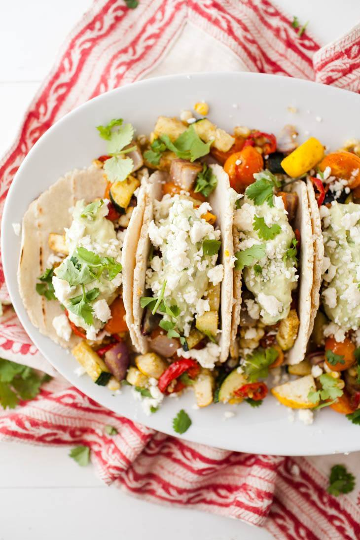 Summer Vegetarian Tacos with Avocado Cream and Feta | http://naturallyella.com
