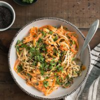 Carrot Rice Noodle Bowl with Tahini-Sriracha Sauce | @naturallyella