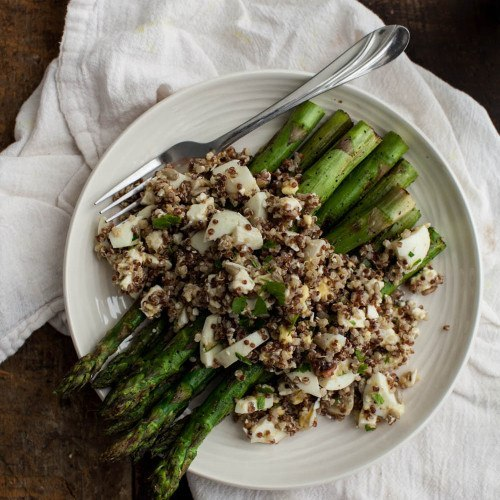 Simple Mustard Egg Salad and quinoa served over grilled asparagus