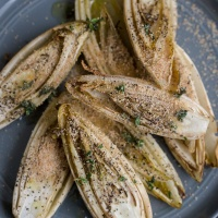Roasted Endives with Thyme Olive Oil and Bread Crumbs