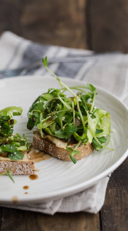 Asparagus and Pea Shoot Crostini with Hummus | @naturallyella