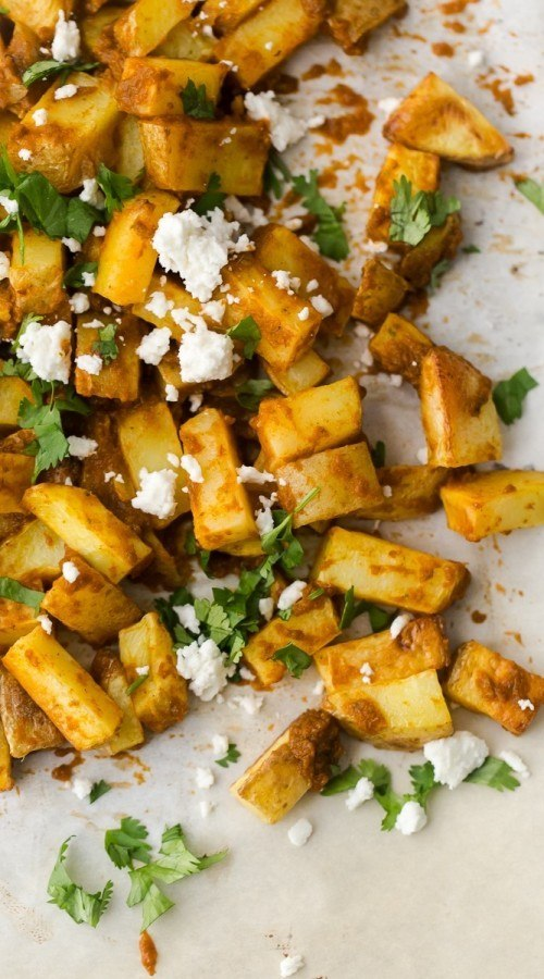 Harissa Roasted Potatoes | http://naturallyella.com