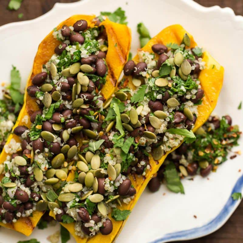Stuffed Delicata with Chimichurri Black Beans | @naturallyella