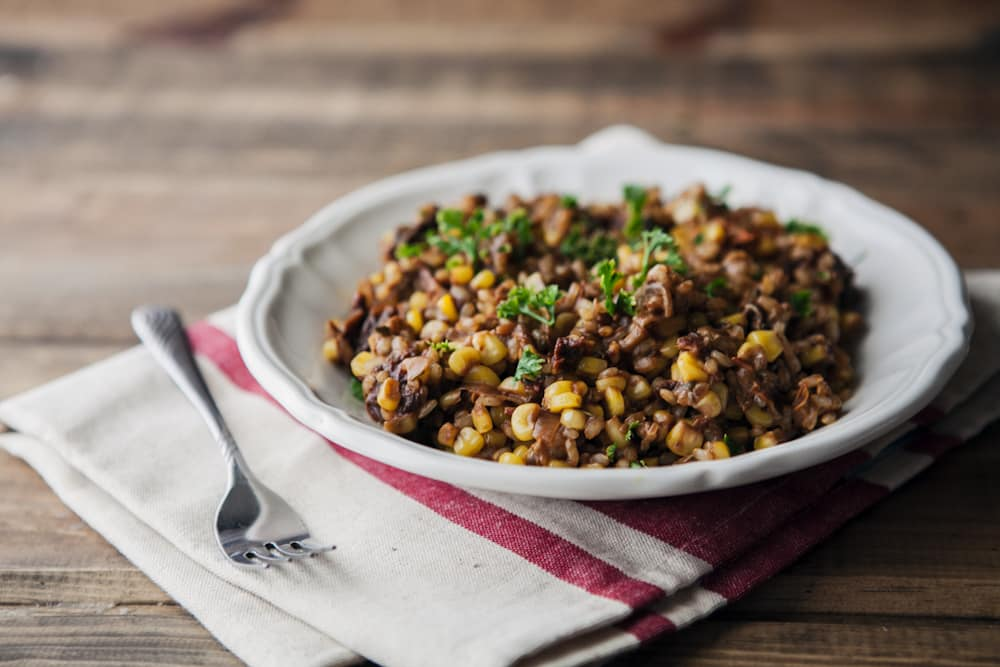 Sun Dried Tomato and Sweet Corn Farro Risotto- Sweet Corn Recipes | http://naturallyella.com