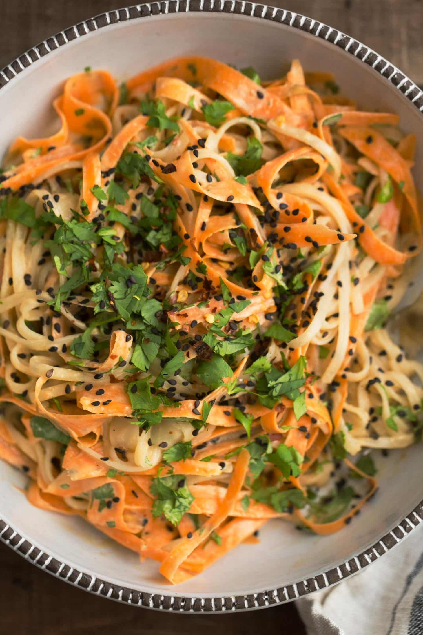 Carrot Rice Noodle Bowl with Tahini-Sriracha Sauce and Cilantro | @naturalllyella