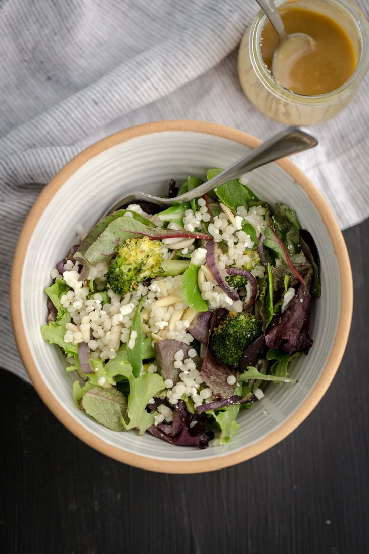 Roasted Broccoli and Couscous Salad with Tahini Dressing   @naturallyella