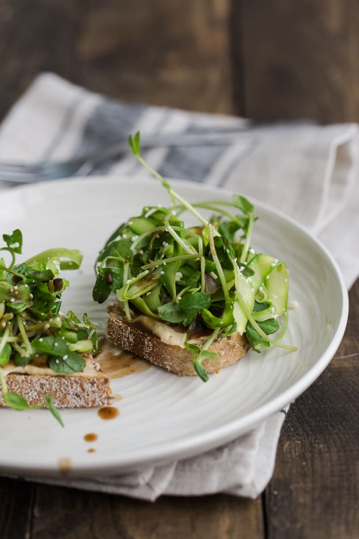 Pea Shoot and Asparagus Crostini with Hummus | @naturallyella