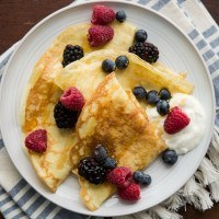 Einkorn Crepes with Fresh Berries and Creme Fraiche | http://naturallyella.com