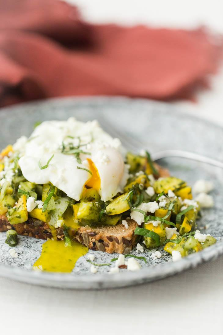 Grilled Pesto Summer Squash Bruschetta with Poached Eggs | http://naturallyella.com