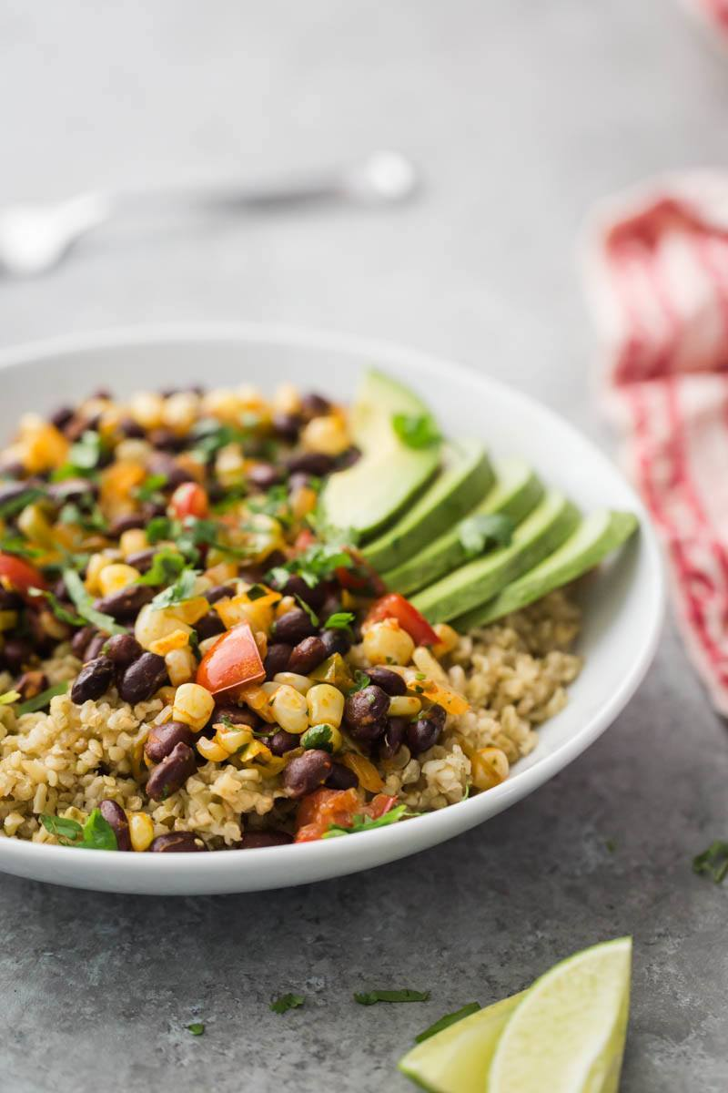 Black Bean Bowl with Freekeh and Avocado | http://naturallyella.com