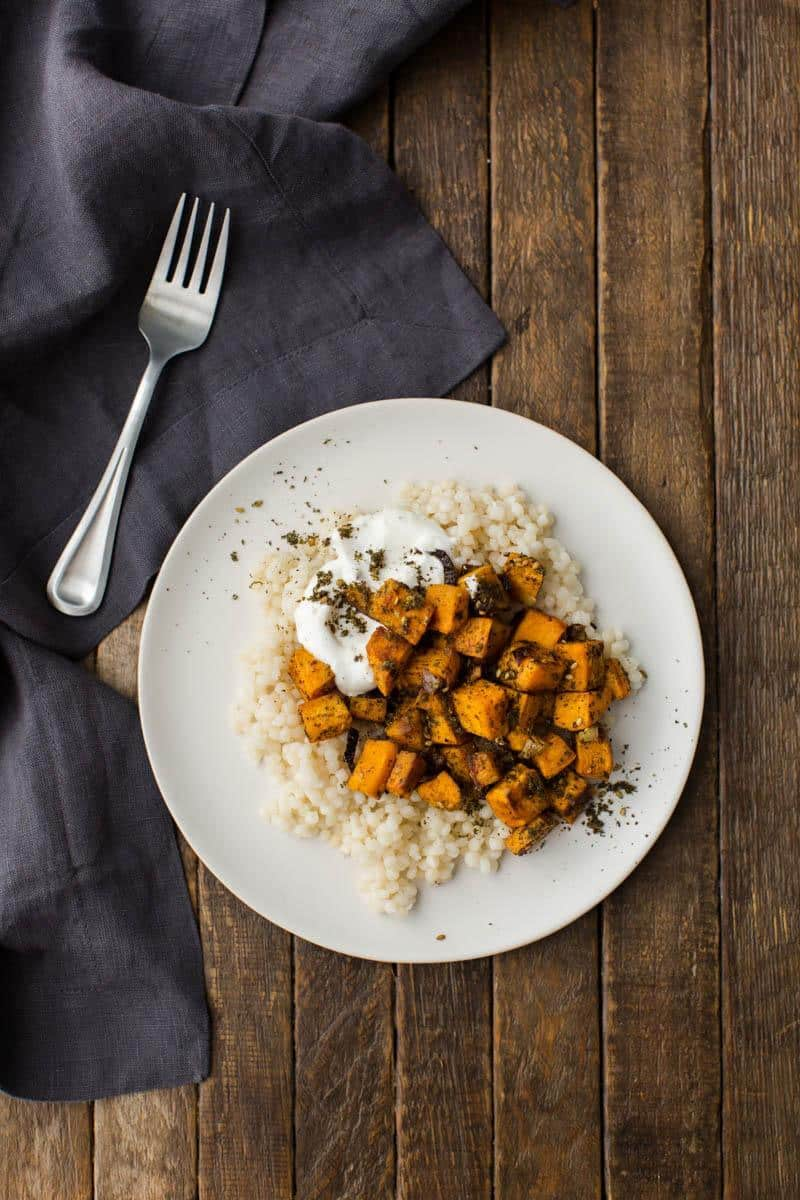Roasted Za'atar Sweet Potatoes with Couscous | http://naturallyella.com