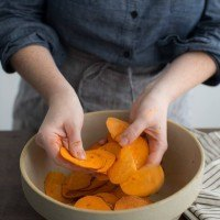 Tossing Sweet Potatoes with Sambal Oelek