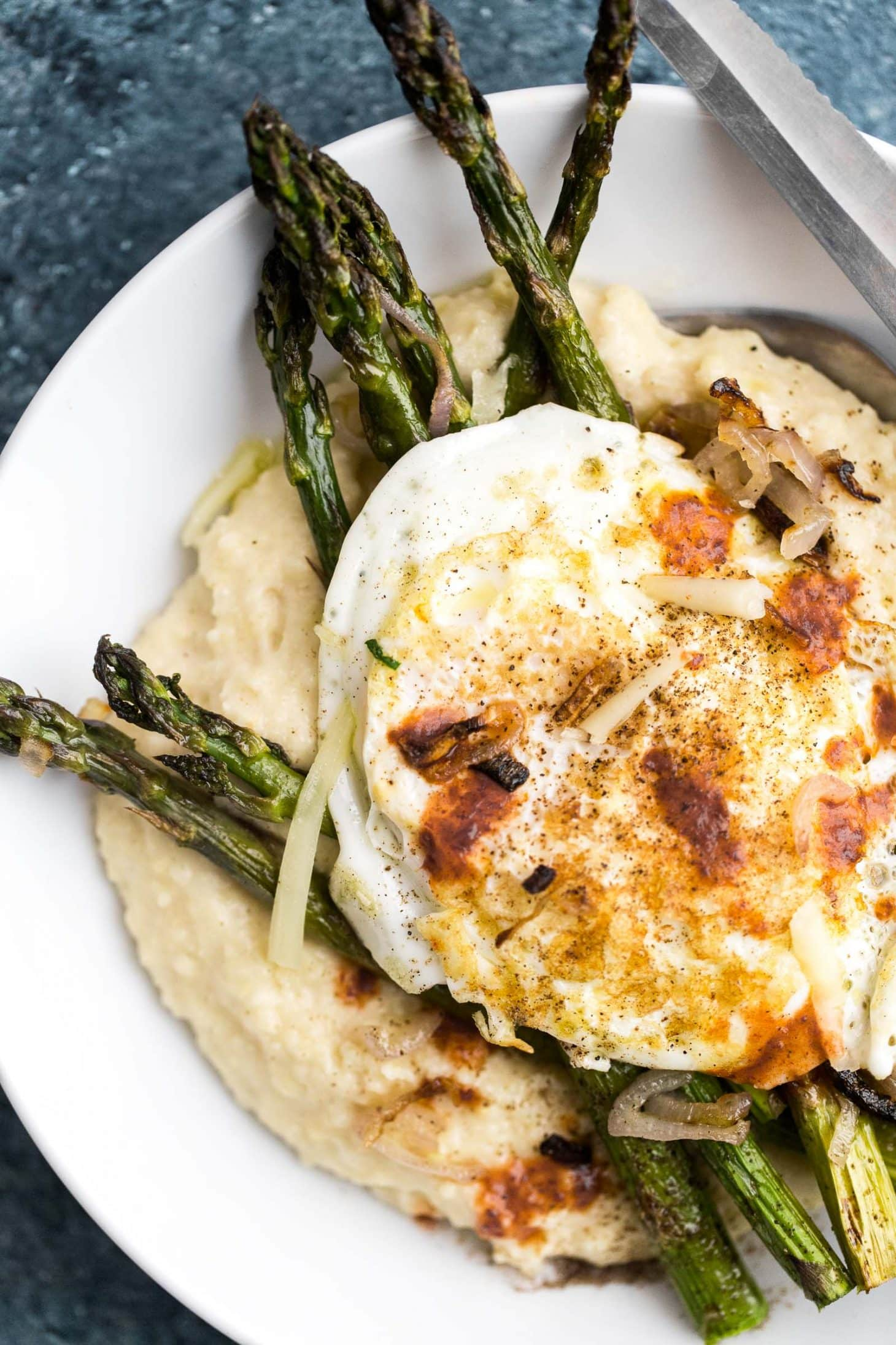 Cheesy Millet Polenta with Roasted Asparagus and Shallots | @naturallyella