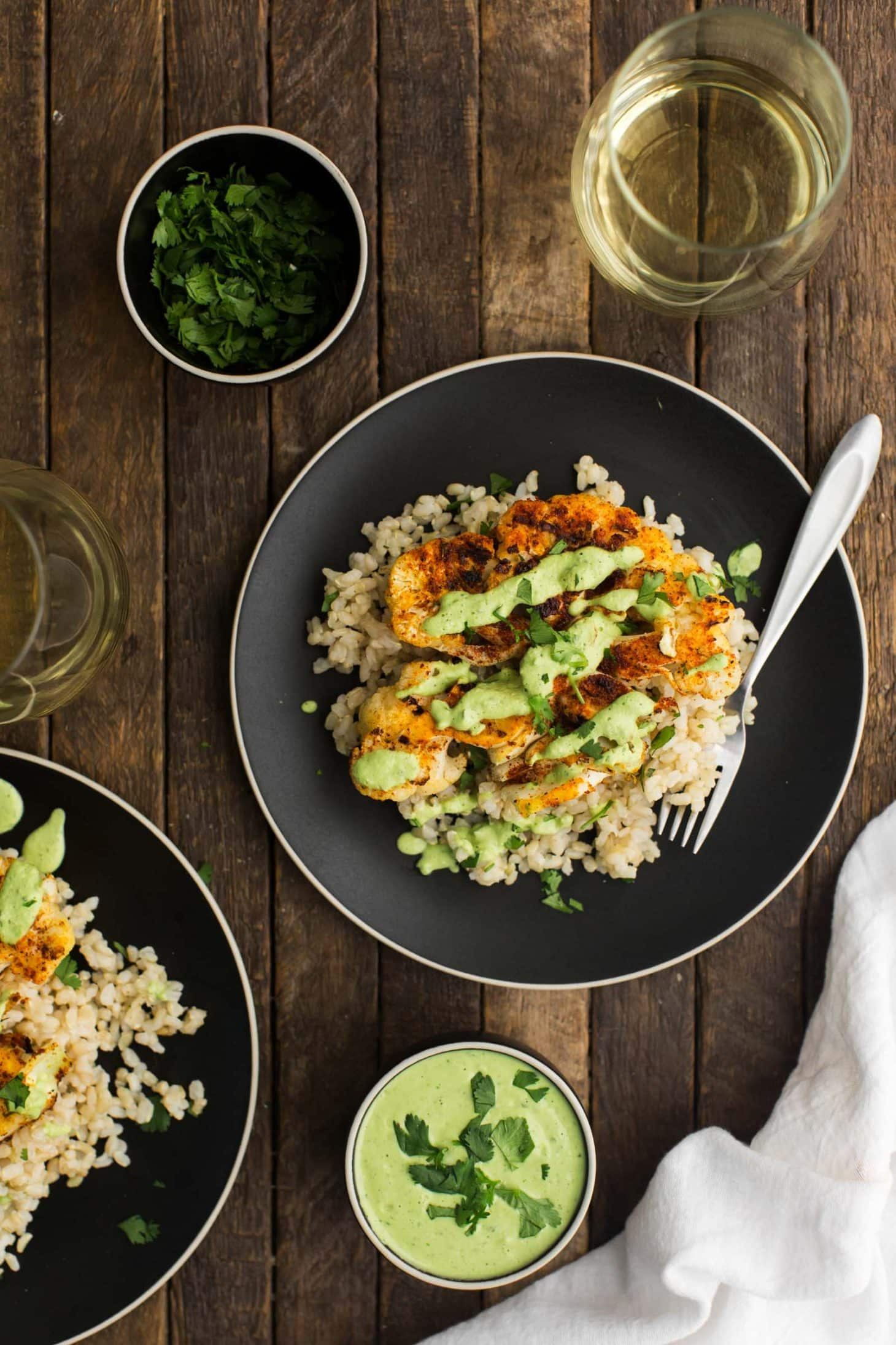 Cajun Cauliflower with Cilantro-Avocado Sauce and Brown Rice | @naturallyella