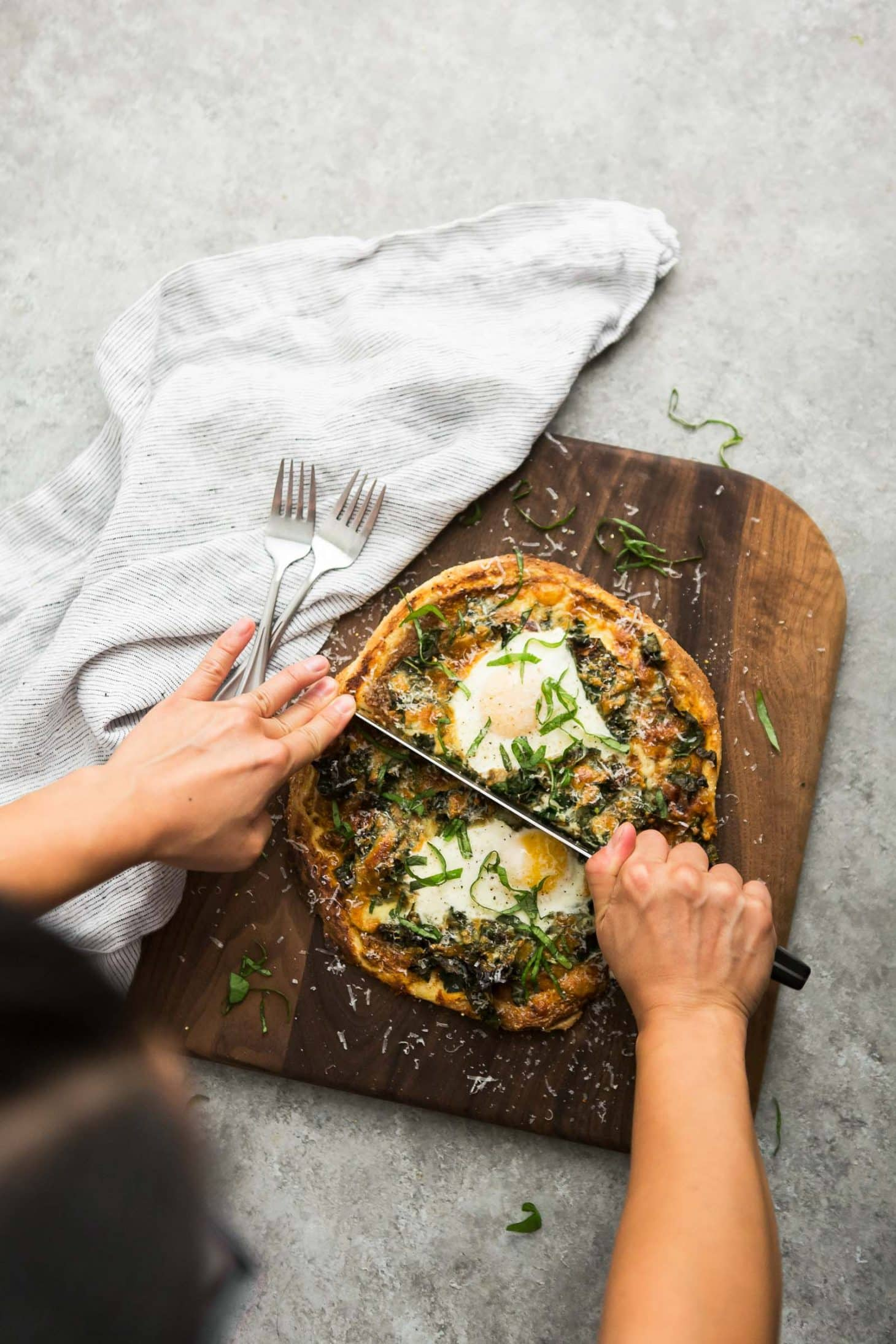 Garlicky Kale Pizza with Homemade Tomato Sauce and Eggs | @naturallyella