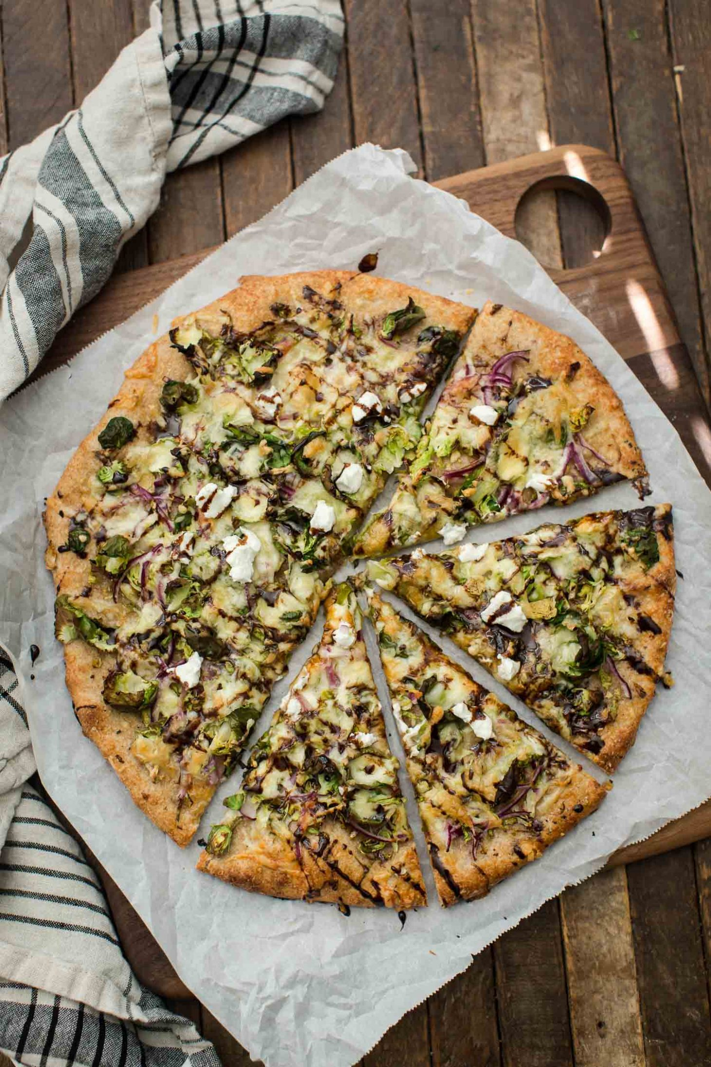 Brussels Sprout Pizza with Goat Cheese and Balsamic Drizzle | @naturallyella