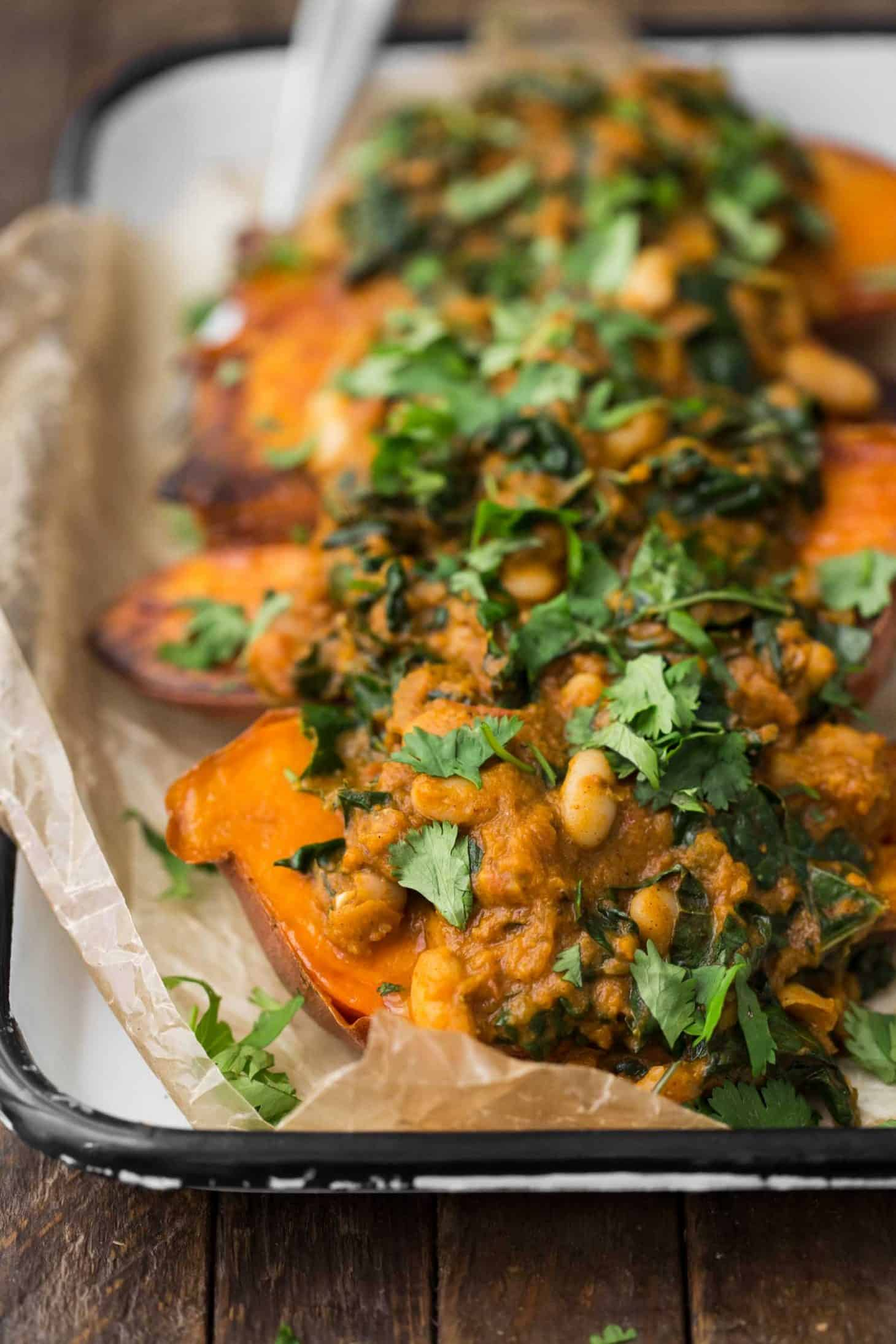 White Bean Masala Smothered Sweet Potatoes with Cilantro | @naturallyella