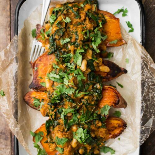 White Bean Masala Smothered Sweet Potatoes | http://naturallyella.com