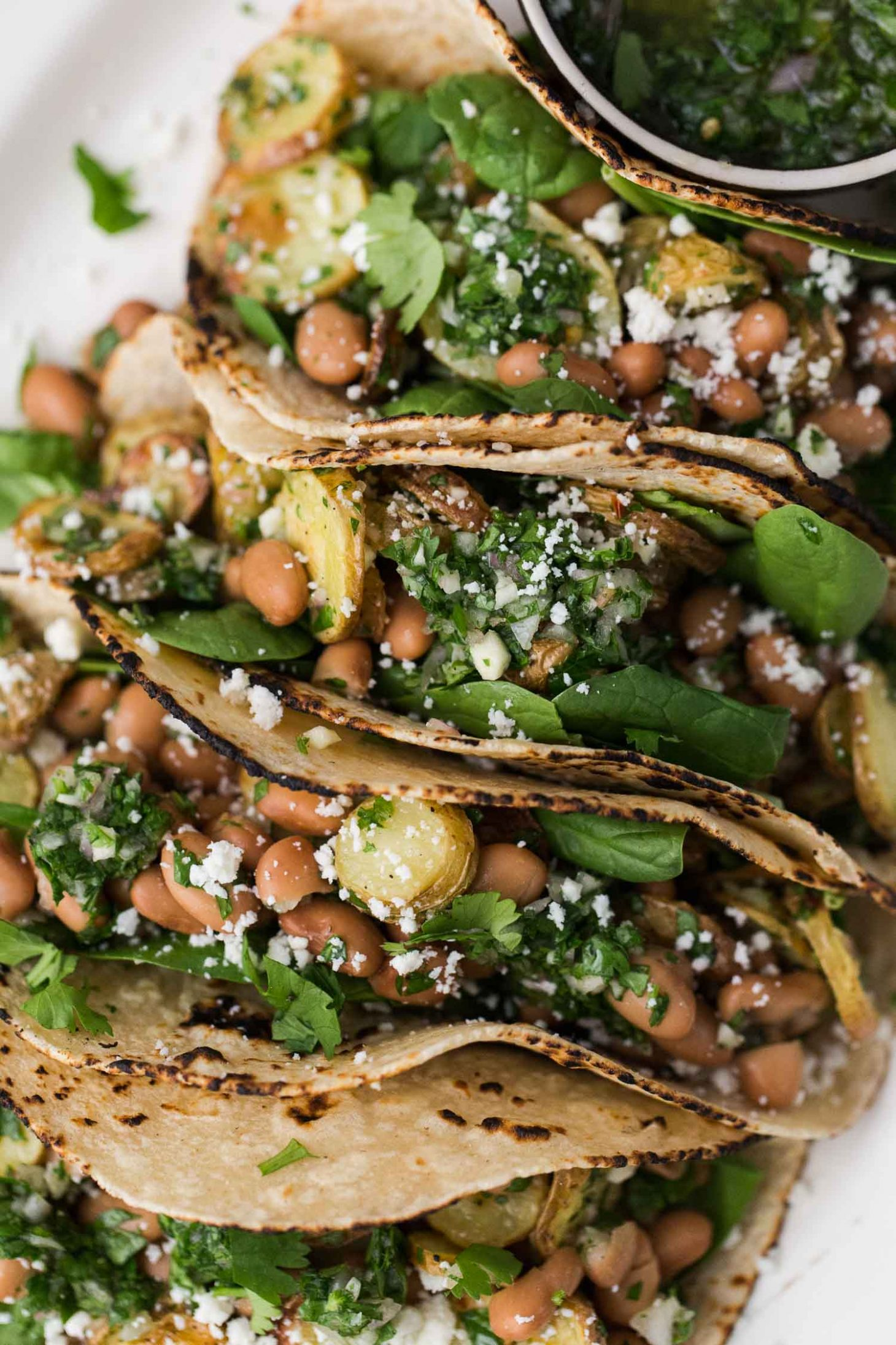 Chimichurri Potato Tacos with Pinto Beans | @naturallyella