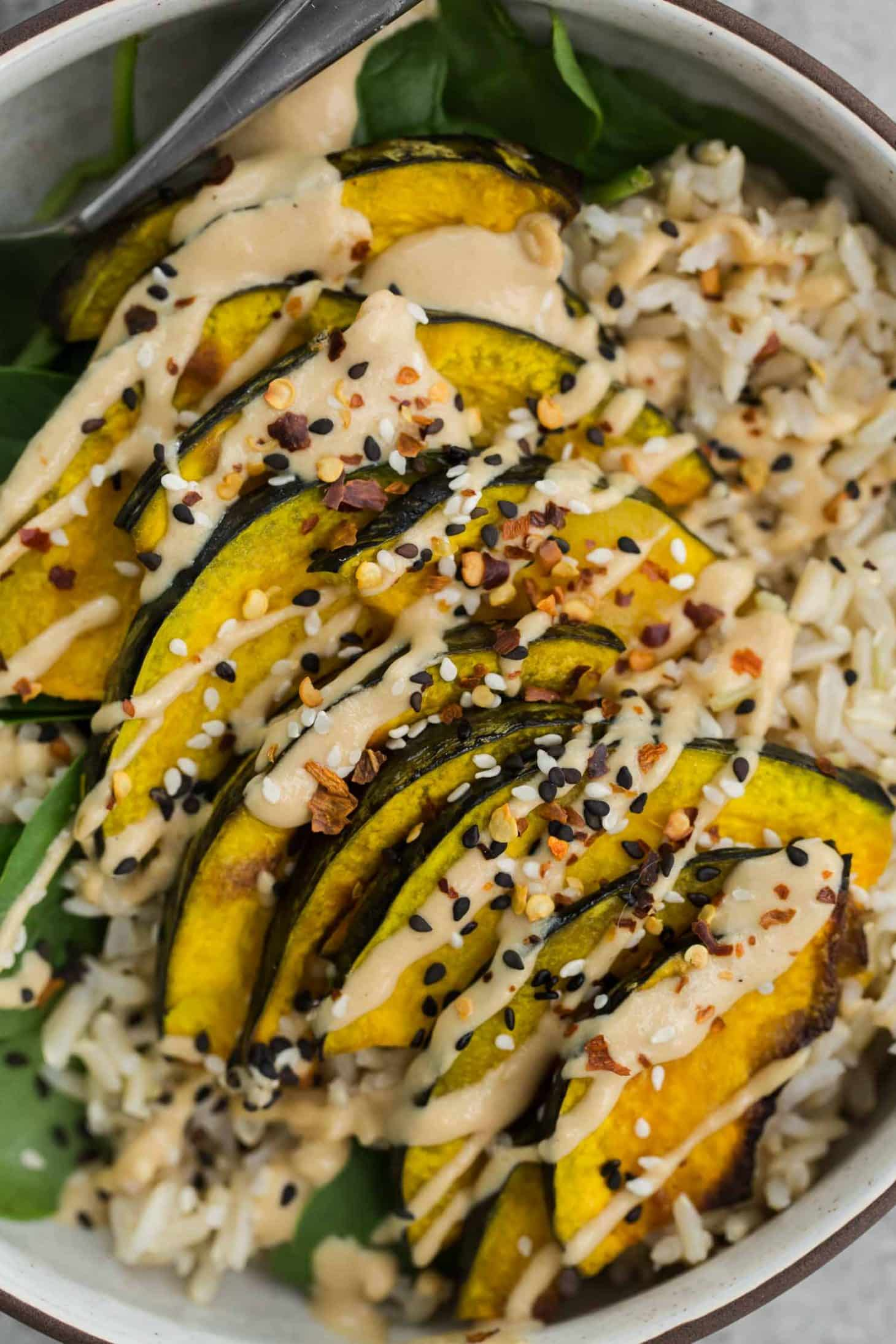 Sesame Kabocha Squash with Tahini Sauce and Brown Rice | @naturallyella
