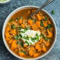 Sweet Potato Barley Stew with Sour Cream and Cilantro | @naturallyella