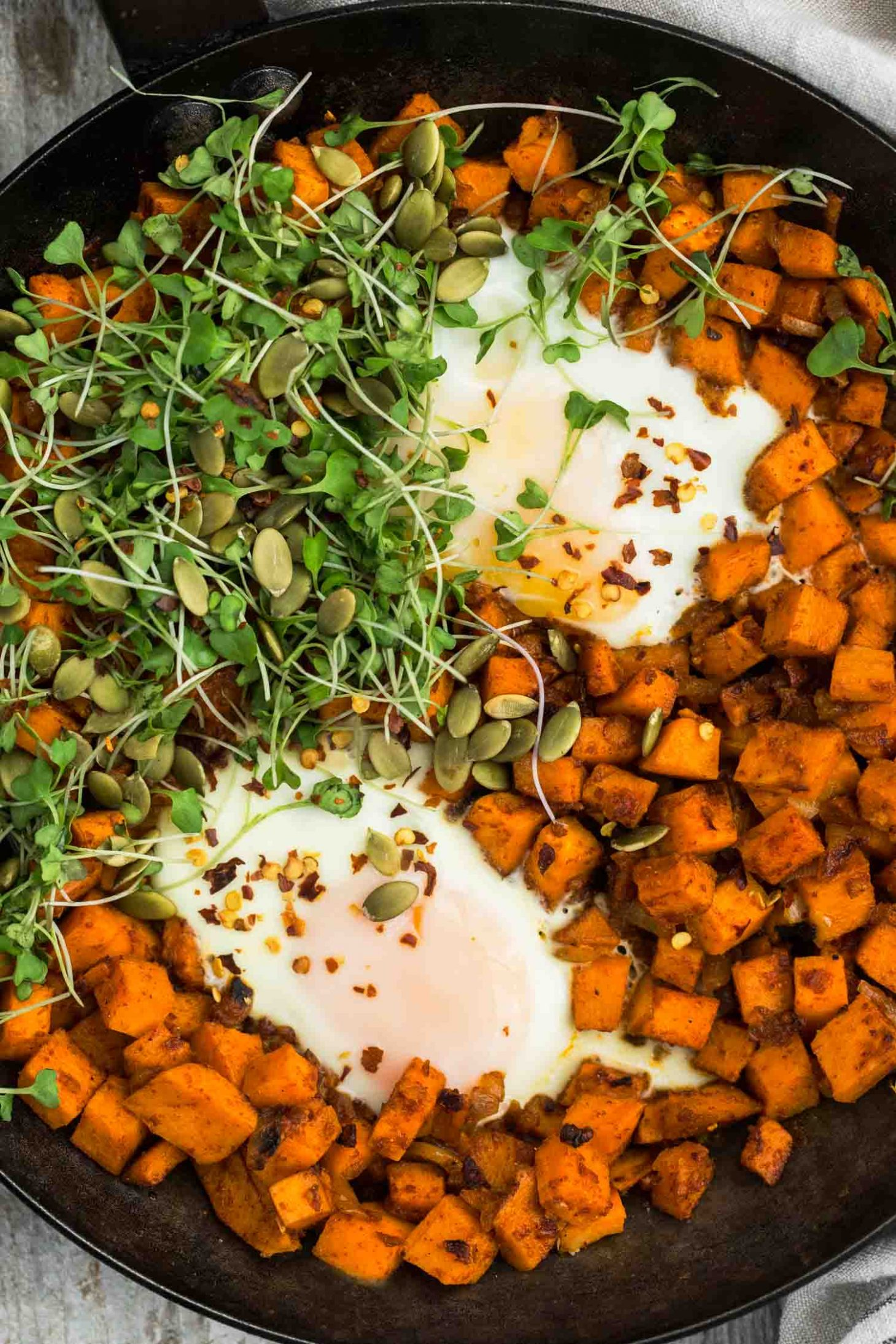 Sweet Potato Hash Egg Skillet with Micro-greens | @naturallyella