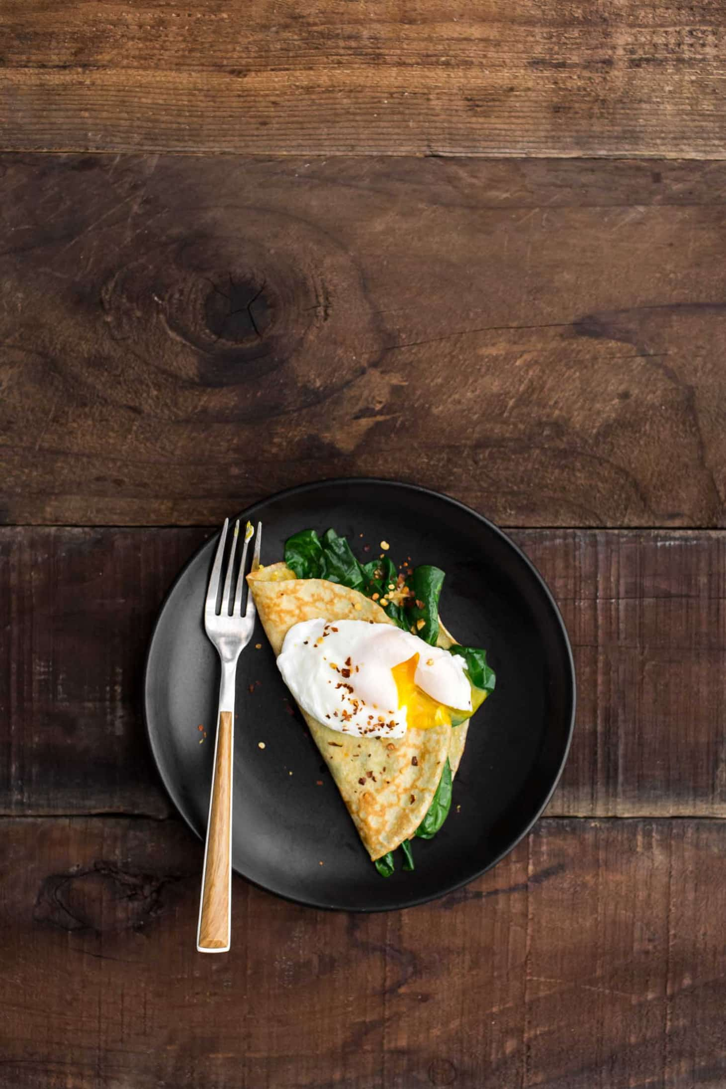 Garlicky Spinach Cornmeal Crepes with Poached Egg | Naturally Ella