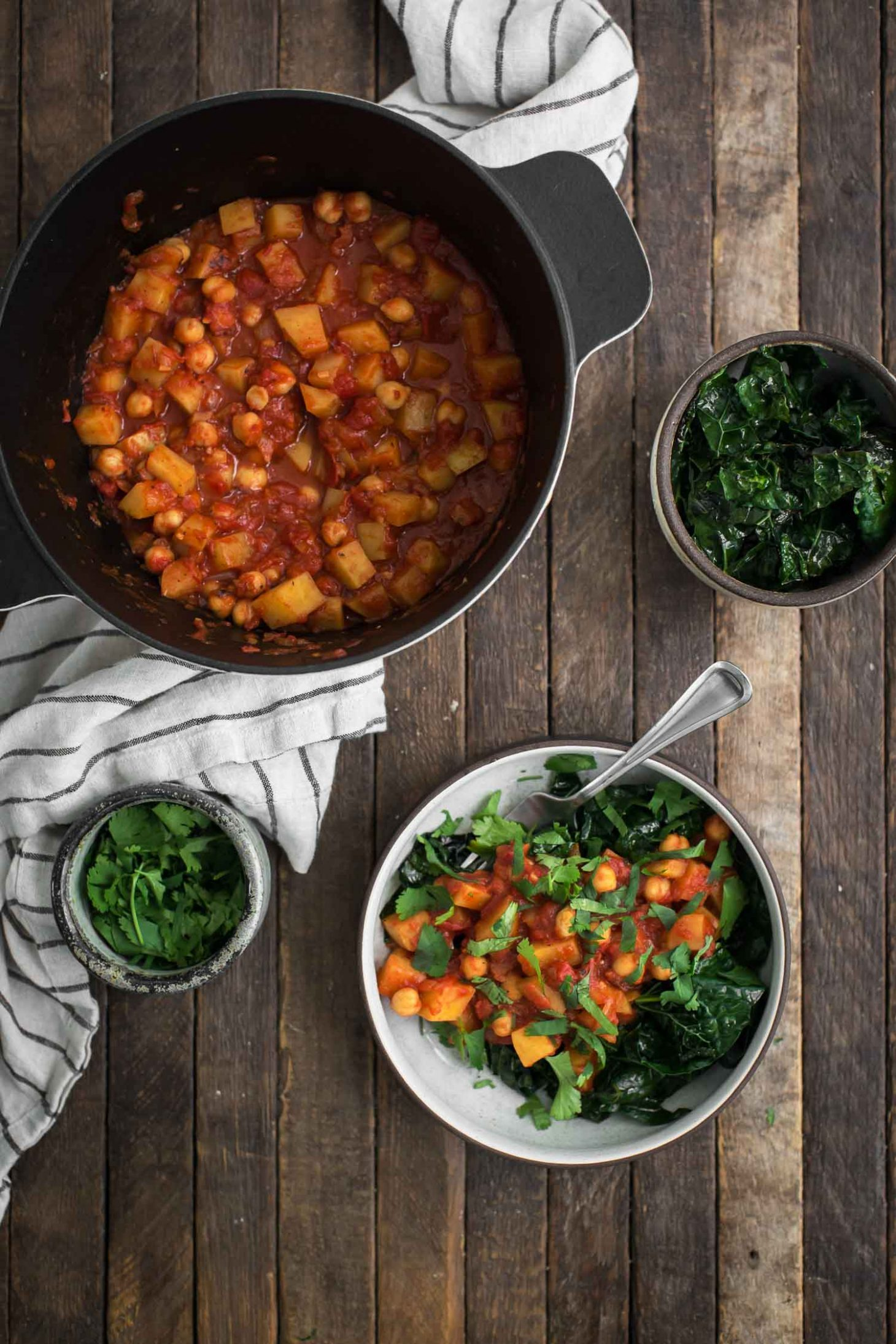 Harissa Potatoes and Chickpeas over Garlicky Kale | Naturally Ella