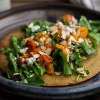 Oat Crisp with Burst Tomato Arugula Salad