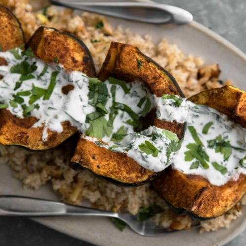 Harissa Acorn Squash with Bulgur and Yogurt Sauce | Naturally Ella