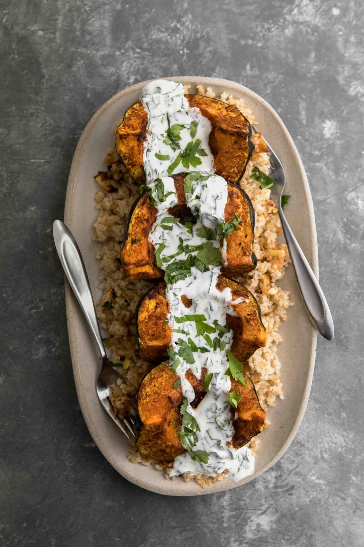 Harissa Acorn Squash with Bulgur and Herbed-Yogurt Sauce | Naturally Ella