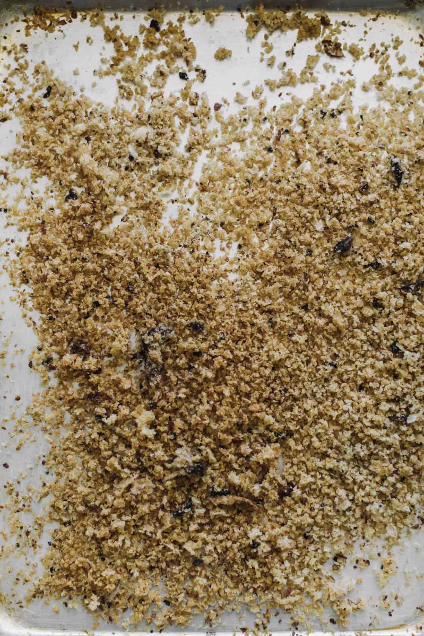 Overhead shot of homemade breadcrumbs on a sheet tray.