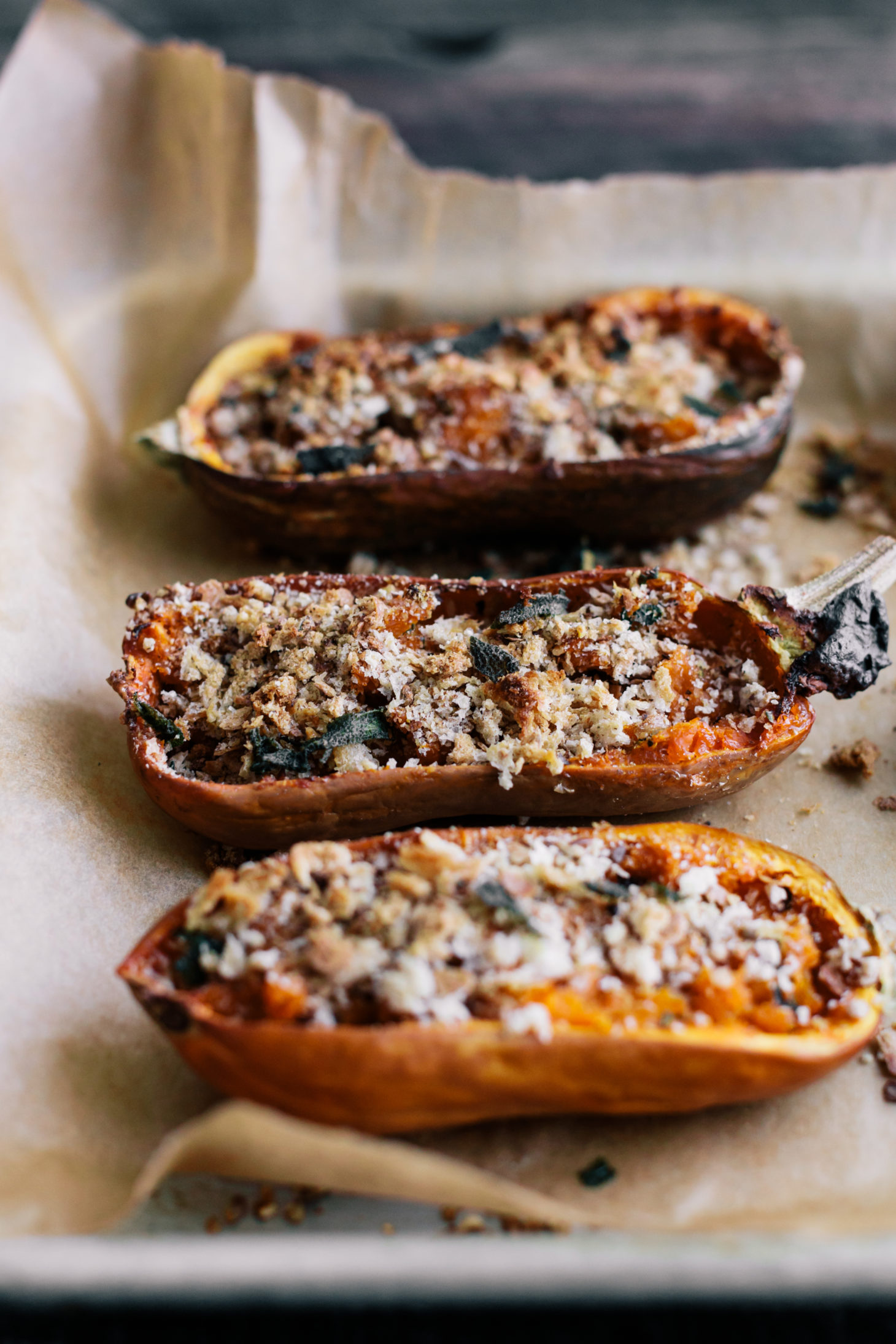 Side shot photo of twice-baked honeynut squash with breadcrumbs and brown butter