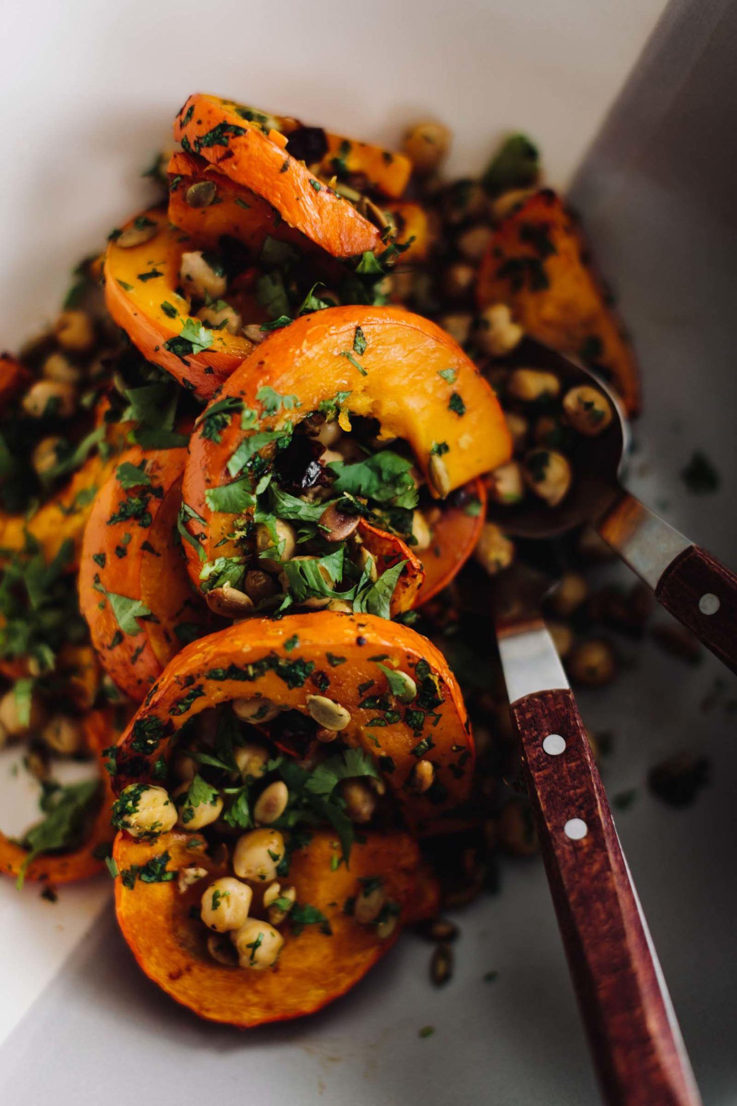 Close-up overhead photo of Chipotle roasted Red Kuri Squash with Chickpeas and herbs