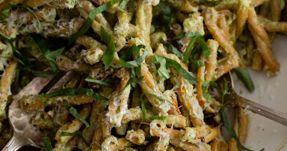Close-up, overhead photo of a bowl of chickpea pasta tossed with a broccoli pesto.