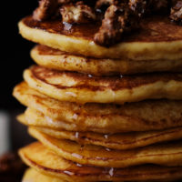 Close-up photograph of a stack of ricotta pancakes made with einkorn flour and kabocha squash puree.