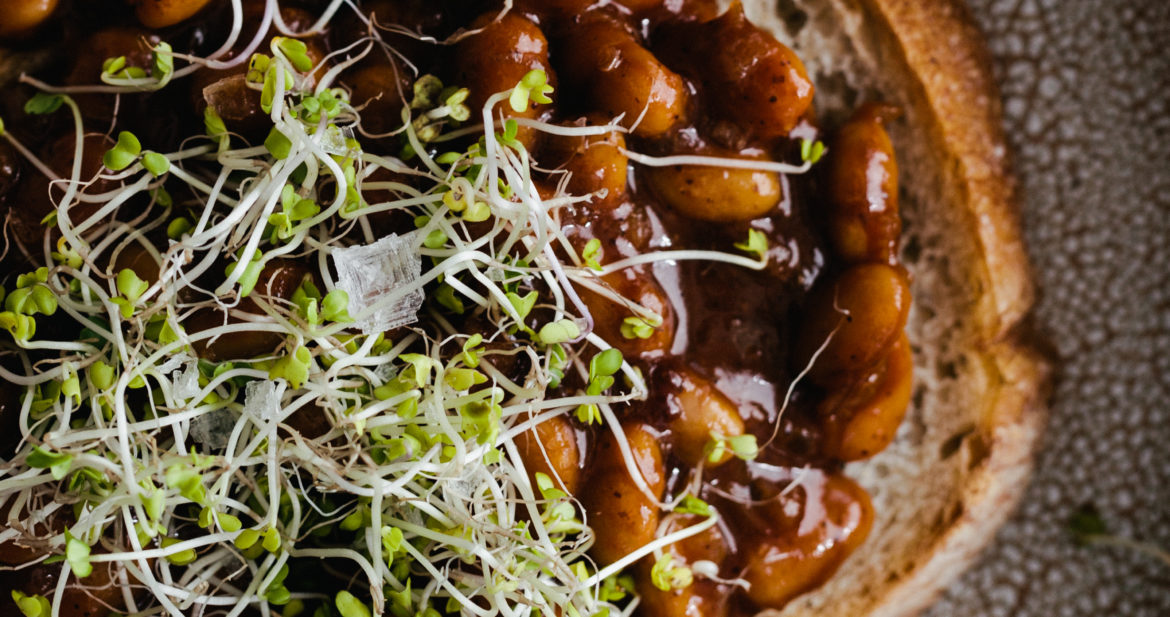 Photograph of Vegan Baked Beans on Toast, topped with microgreens