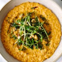 Sunflower Carrot Risotto with Hazelnut-Pea Shoots