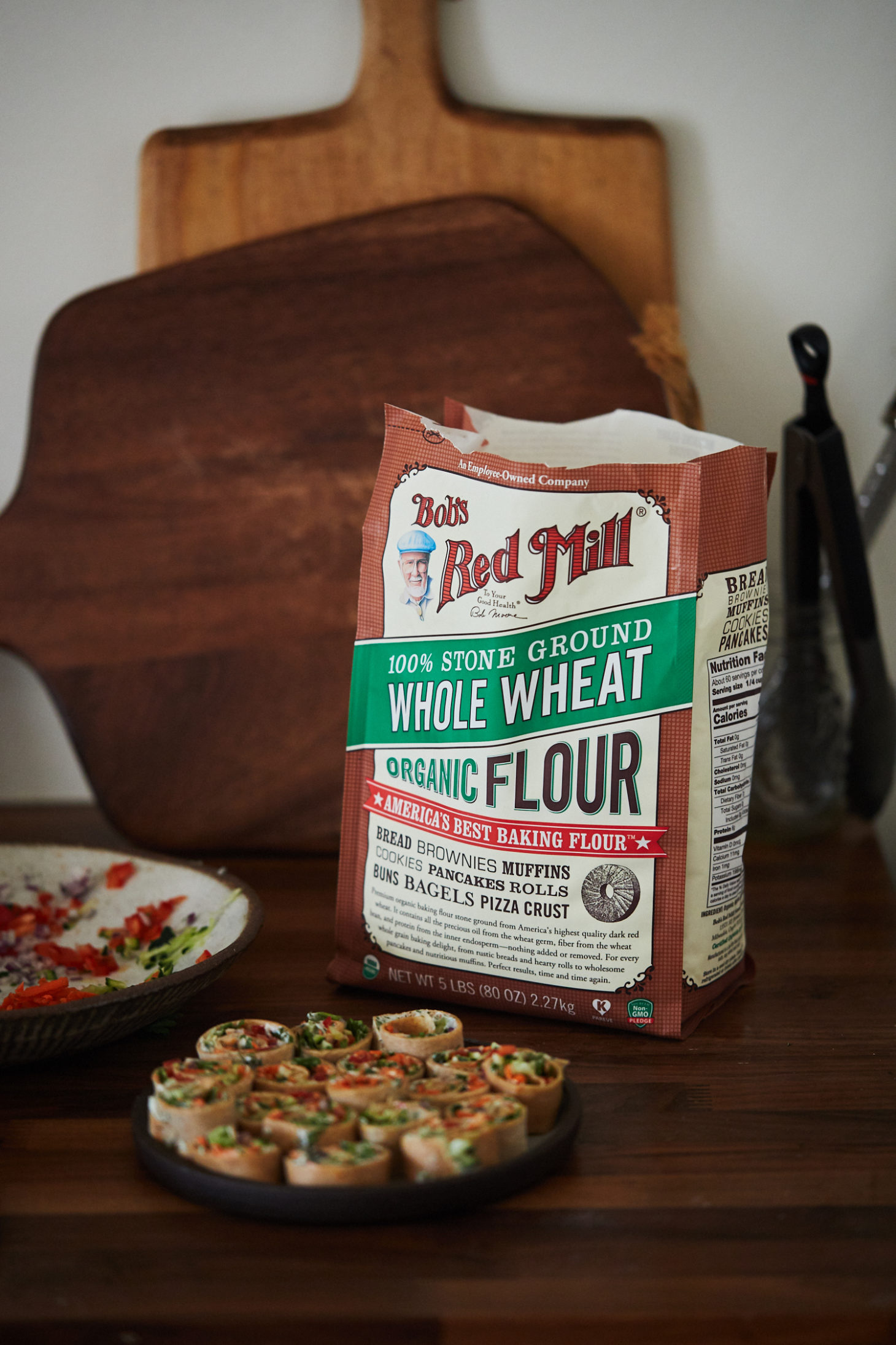 A straight-on photograph of a bag of bob's red mill whole wheat flour.