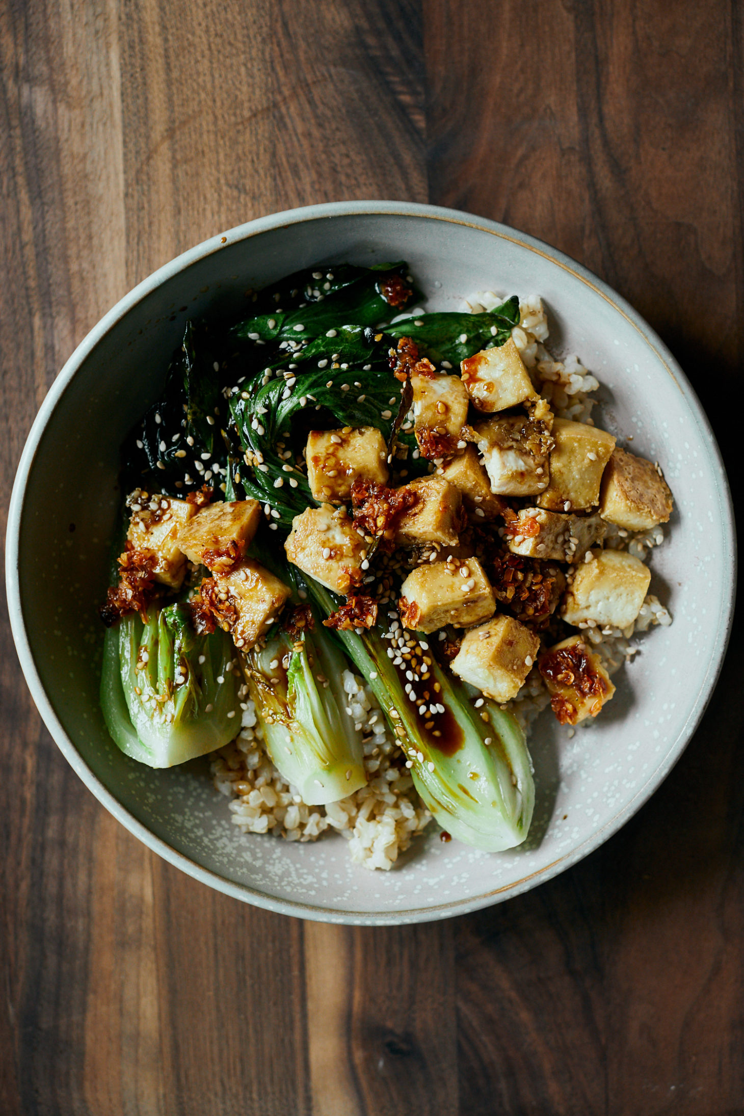 overhead photograph of a rice bowl with crispy tofu and seared bok choy
