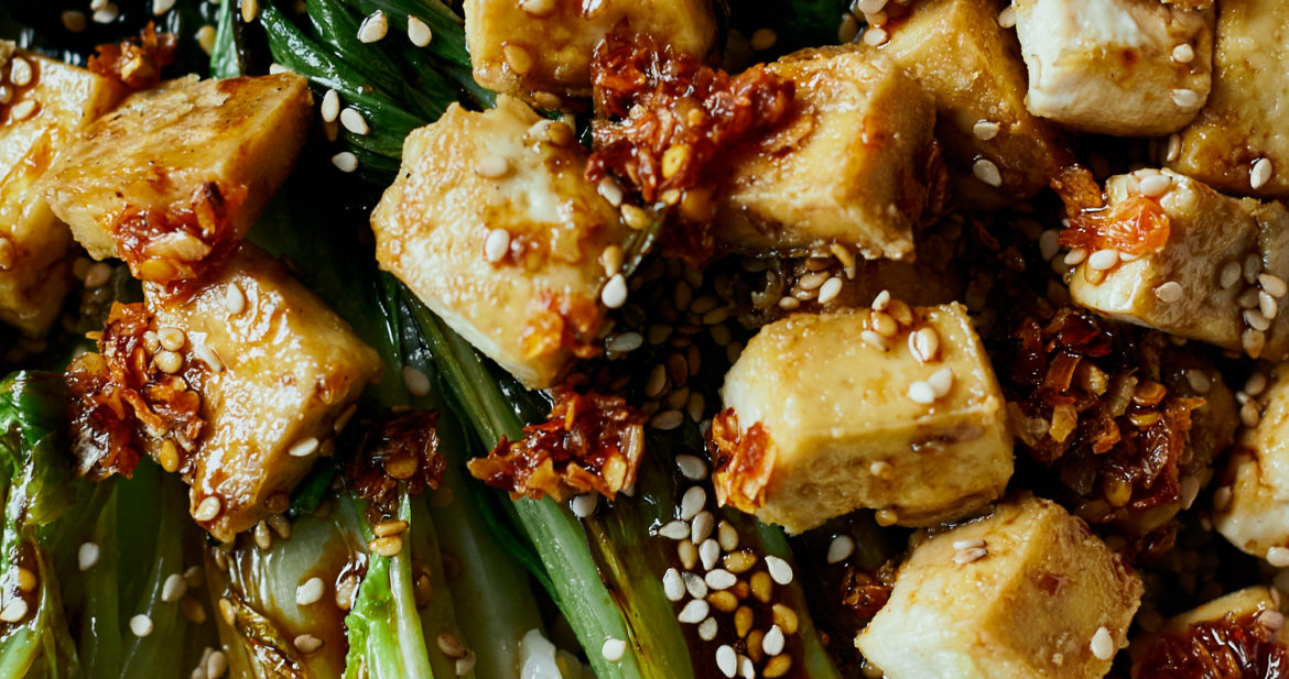 close-up photography of crispy tofu on top of seared bok choy halves and rice