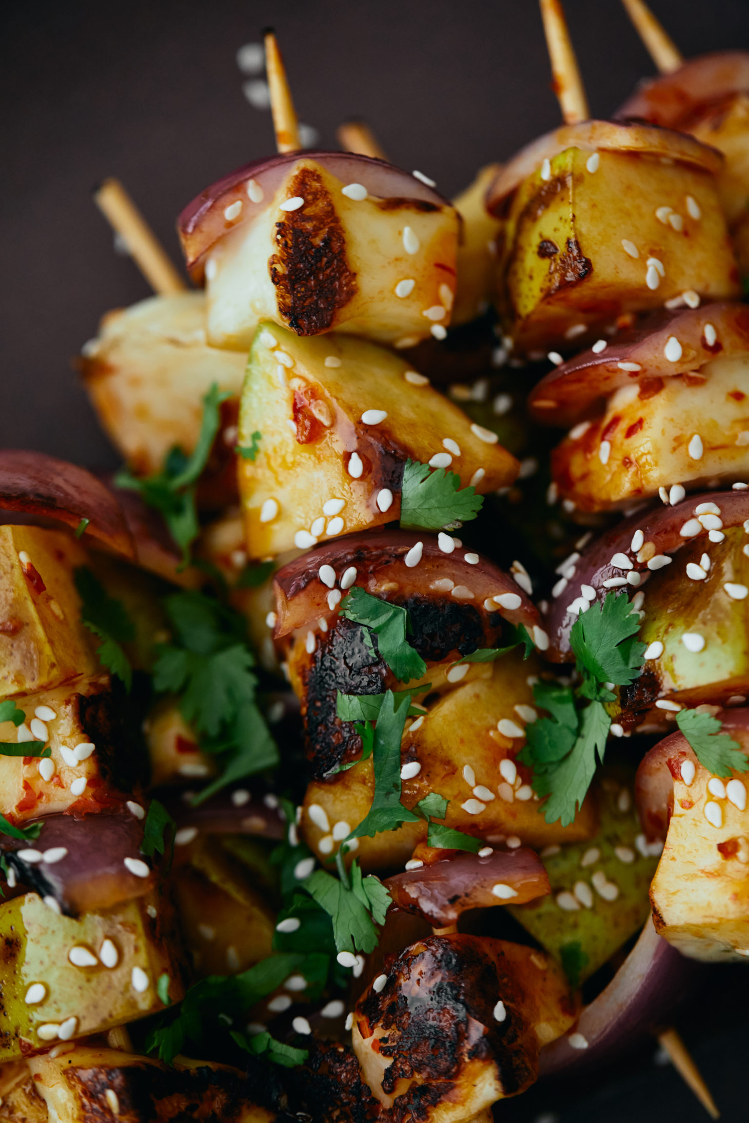 Close-up image of grilled pear skewers.