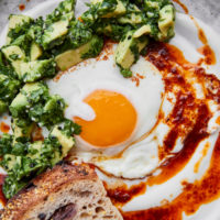 Turkish Eggs with Harissa Butter and Avocado Relish