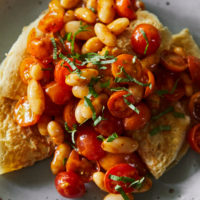 Oat Crepes with Harissa Beans and Tomatoes